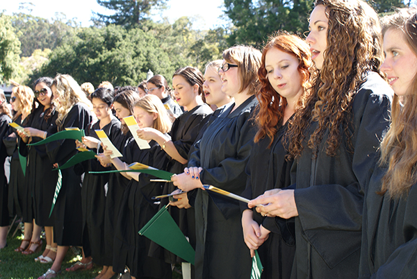 The Class of 2014 sings the Mills College Hymn,