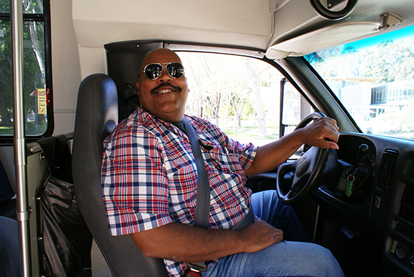 Oscar Warren has worked as a shuttle driver at Mills for the past 9 years. (Photo by Natalie Meier)