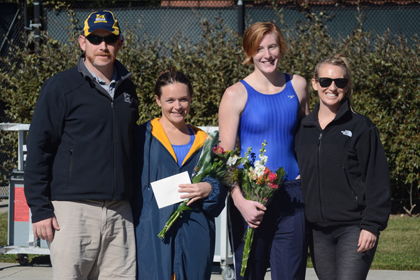 Head Coach Neil Virtue (far left) poses with graduate student Amelia True (center left) and senior Jessica Lix (center right). (Photo by Jen Mac Ramos)